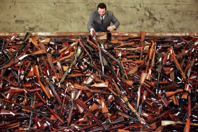 Mick Roelandts, firearms reform project manager for the New South Wales Police, looks at a pile of a..